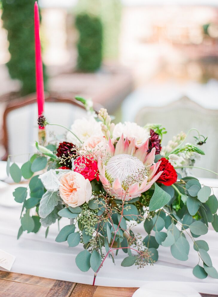"Michelle and Michael's centerpieces complemented her bouquet with a blush king protea, eucalyptus and garden roses in different hues. All were arranged by Peplum Events and Design. ""I had shot her wedding a few years back and had seen her work evolve over time. I loved working with her and felt she was the best person for our wedding,"" says Michelle."