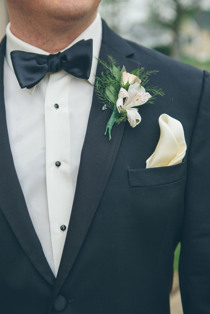 Kyle and his groomsmen wore black tuxedos with black bow ties, ivory pocket squares and white alstroemeria boutonnieres.