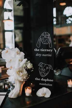 Black and White Dog-Themed Bar Sign with Orchid Arrangement