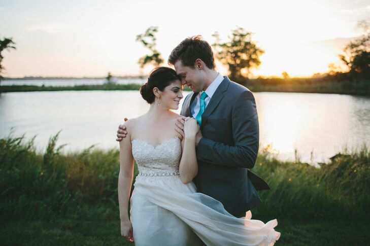 """Jess fell in love with the Modern Trousseau dress, with a strapless bodice accented in gorgeous Italian lace. """"The one thing I didn't expect was just how perfectly this dress would be outside, on the water, where the breeze flowed and made the dress take on a wonderful life of its own,"""" Jess says."""