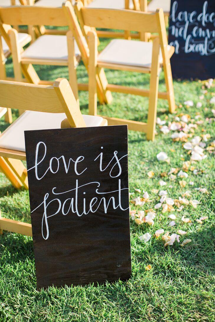 "Handwritten chalkboard signs featured words from 1 Corinthians 13:4-8: ""Love is patient, love is kind. It does not envy, it does not boast, it is not proud."""