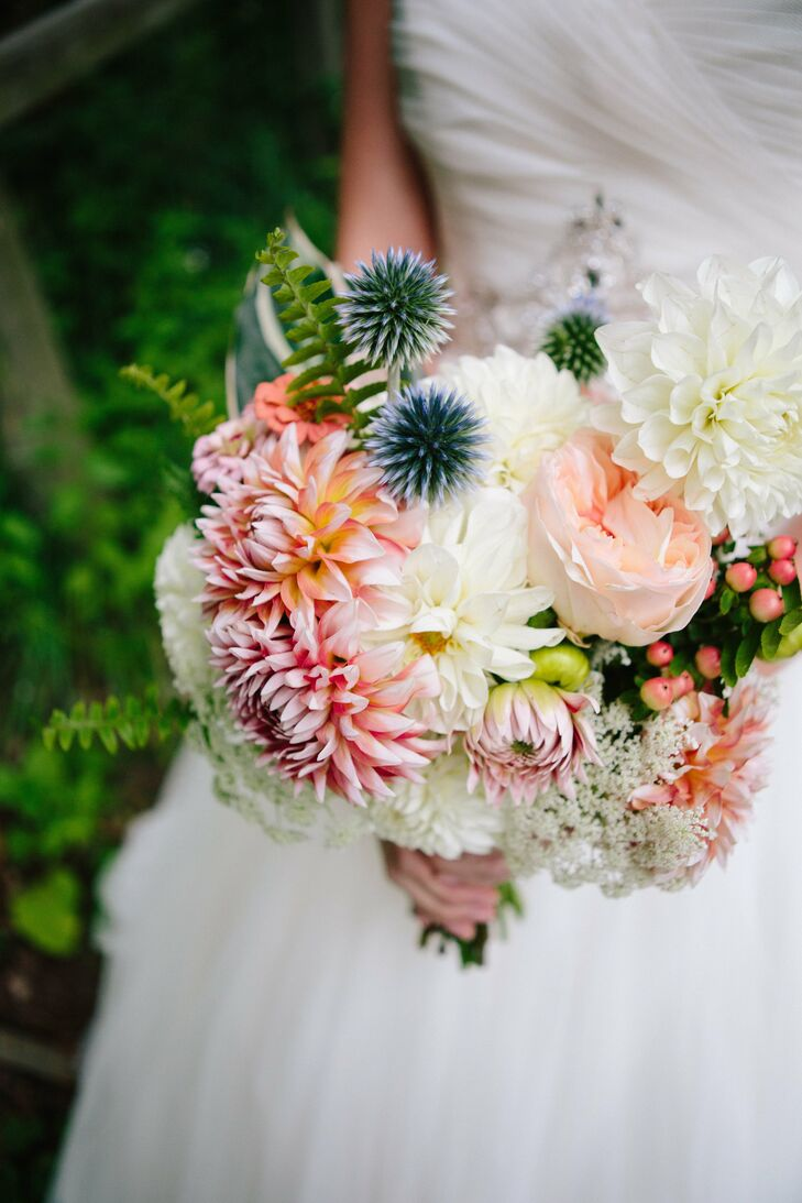 The bridal bouquet was a mix of pink and white peonies and dahlias, complemented by hypericum berries and blue thistle.