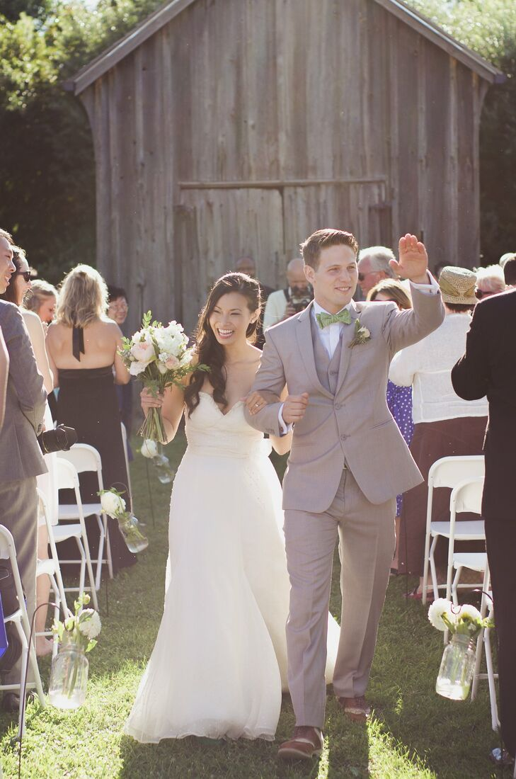 The couple held their wedding at the open-air Markham Museum where a 100-year-old rustic barn served as the backdrop for their summer ceremony.