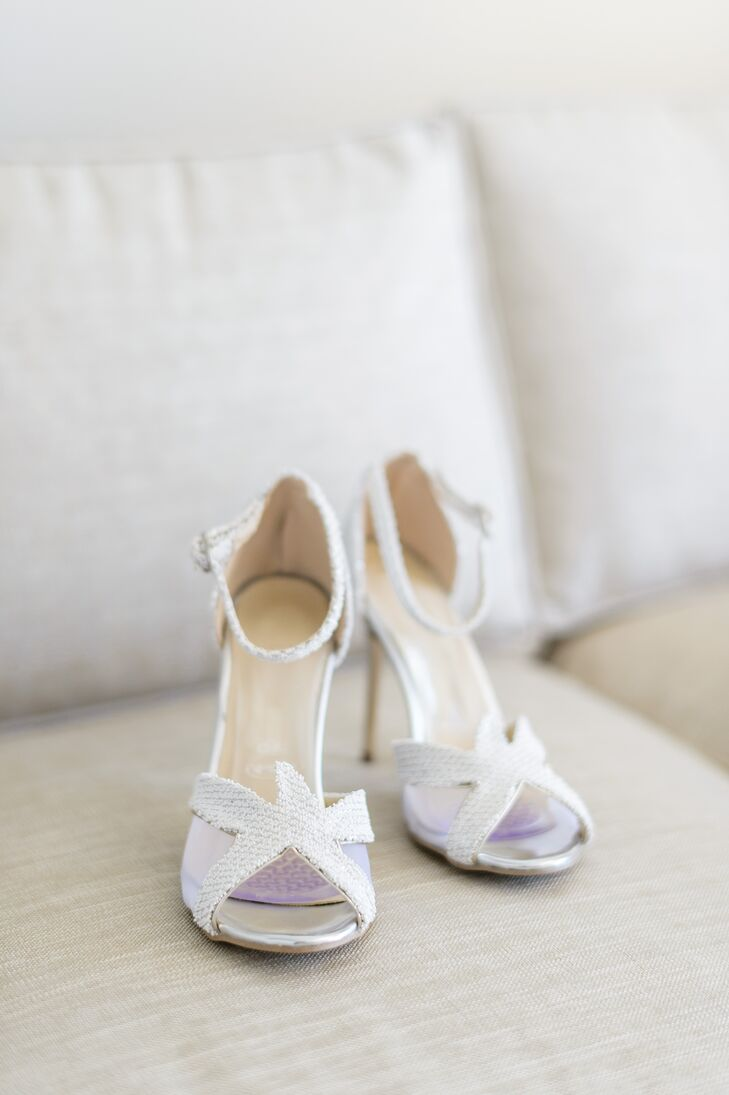 """Nicole's down-the-aisle accessories paid tribute to the locale. The bride teamed her romantic mermaid-style Marisa gown with a pair of shimmery white starfish-accented pumps. """"The shoes were inspired by Charlotte Olympia's Sandrine Starfish shoe, which I had fallen in love with,"""" Nicole says. """"They were way out of my price range, but my mom came to the rescue with a nearly identical lookalike."""""""
