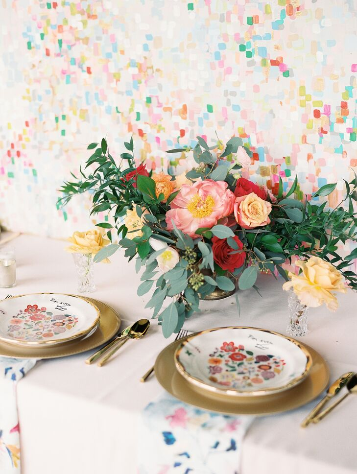 A palette of eye-catching, citrusy tones; painterly décor elements; and bright, colorful blooms lent Katie Cox and Tyler Cooper's personality-packed w