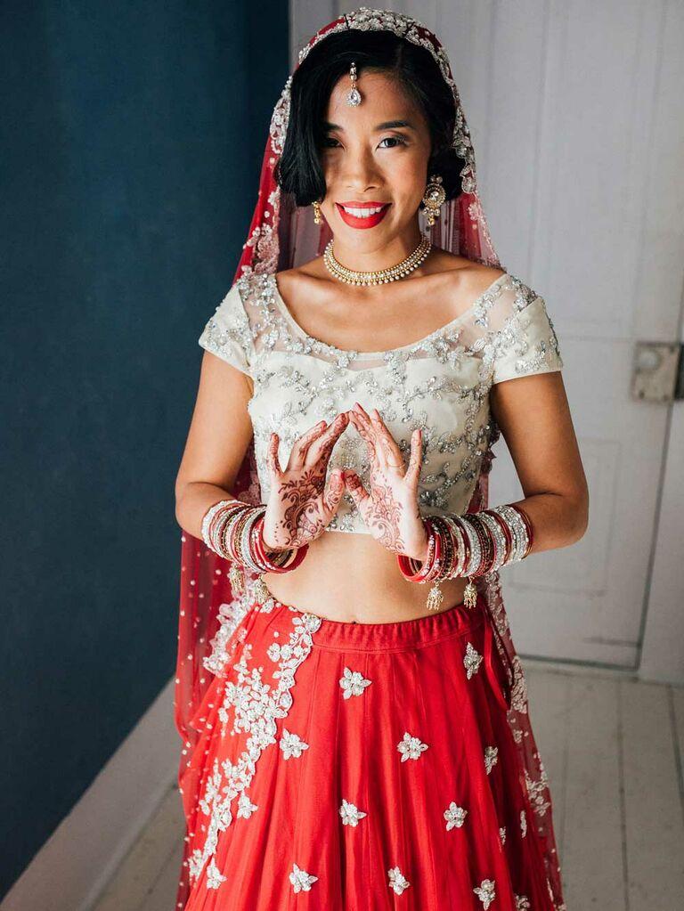 Bride wearing red and gold lehenga choli