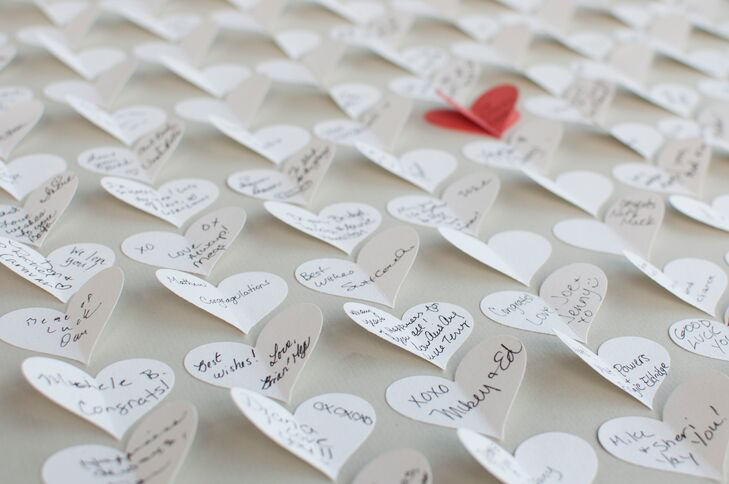 Guests signed small hearts on a poster board instead of a guest book.