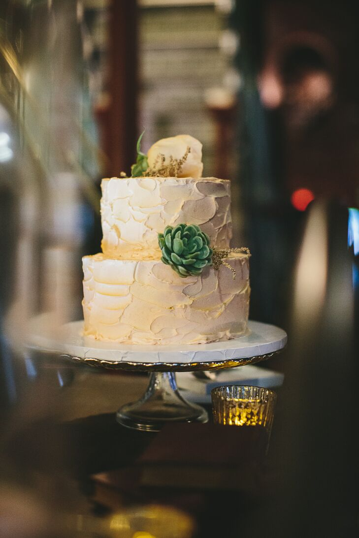 Jordan and Jacob finished the meal with a simple two-tier wedding cake, which had a subtle gold tone—echoing chic, warm decor of the reception at Metropolitan Waterworks Museum in Chestnut Hill, Massachusetts.