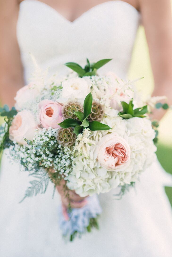 """""""I took photos off of Pinterest and shared them with our florist as a starting point,"""" the bride says. """"She really brought my vision to life -- I leaned on her expertise and the arrangements turned out better than I could have imagined!"""""""