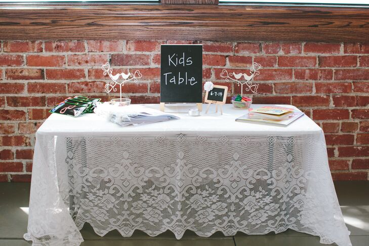 Wanting to ensure that all of their guests had fun, Kaleigh and Jeff provided their younger guests with a table stocked with crayons, coloring books and glow stick glasses.rn rn