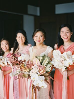 Bridesmaids in Coral Dresses with Anthurium Bouquets in Phuket, Thailand