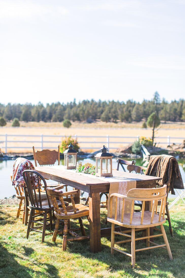 Rustic lanterns were set around the dining tables, which were set up just a few steps away from the ceremony site at Abigail's parents' home in Bend, Oregon.
