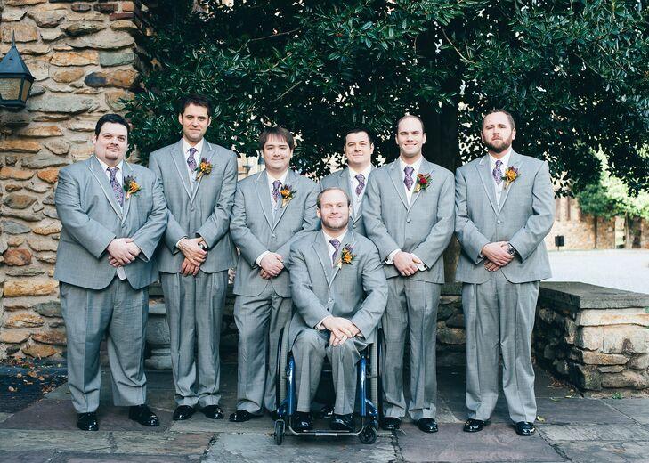 Adam's groomsmen wore light gray suits and purple paisley ties.