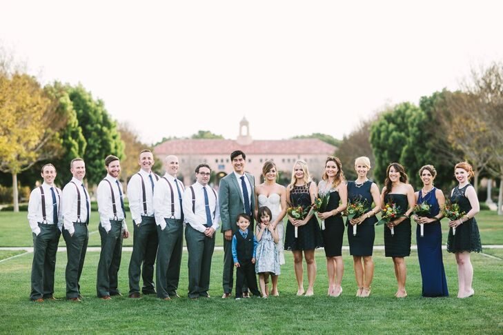 The bridesmaids wore their own navy dresses while the groomsmen wore casual gray slacks, leather suspenders and navy ties for a shabby chic look.