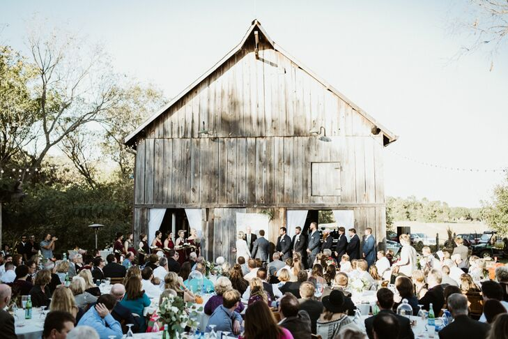 Guests sat outside the barn for the ceremony, then moved to the patio for the reception. The barn houses a large bar and several bar-top tables and stools and was open throughout the night for guests to have a snack or drink and mingle.