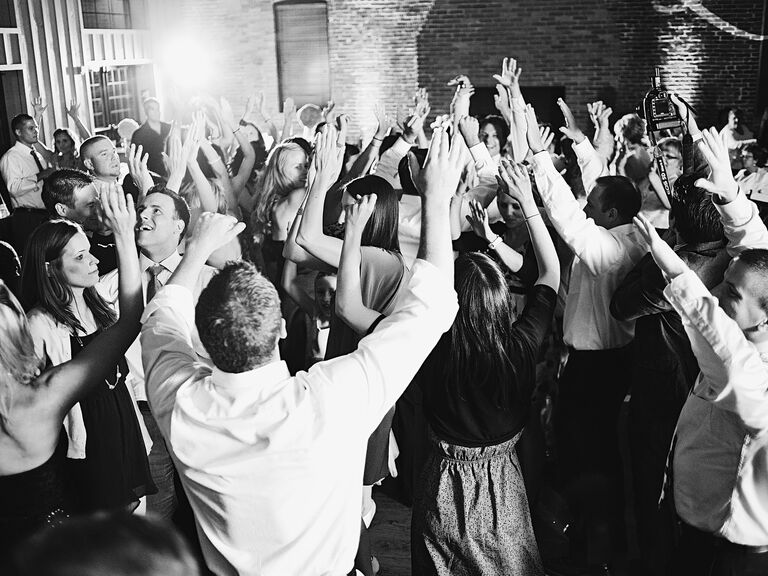 Wedding Reception Guests Dancing With Arms Up