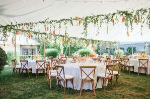 Flower Filled Reception Tent with Cross-Back Chairs at Solé East in Montauk, New York