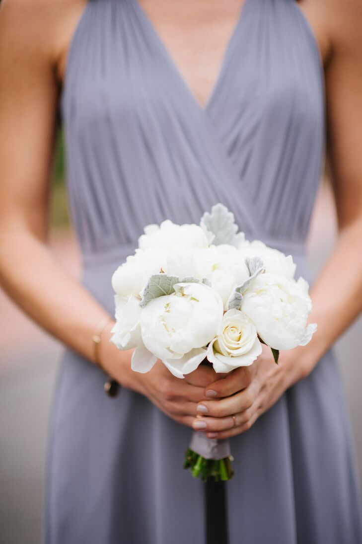 The bridesmaids carried smaller versions of the bride's bouquet, including white peonies, white roses and gray dusty miller.