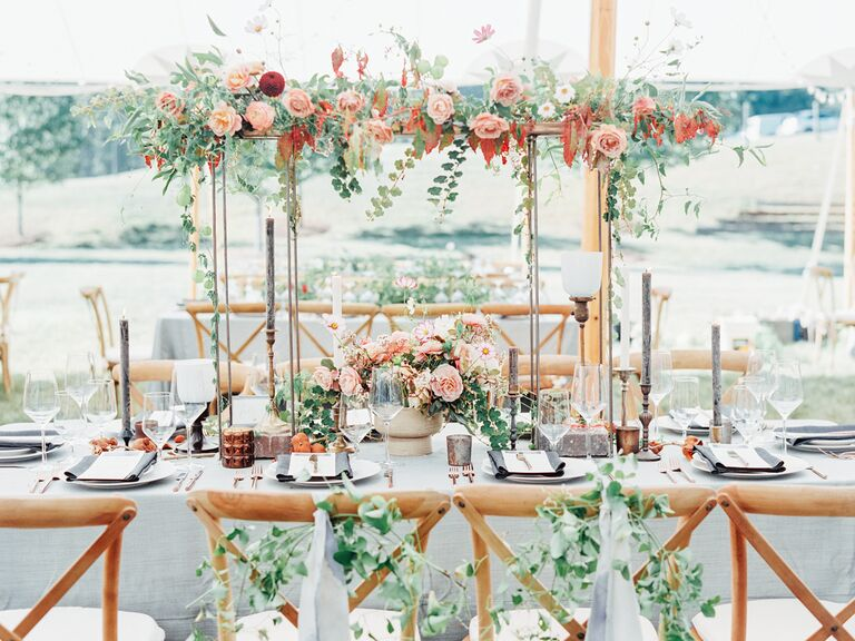spring wedding centerpieces tall runner of greens and flowers