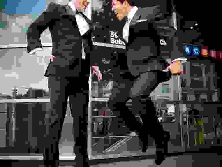 Grooms jumping for joy
