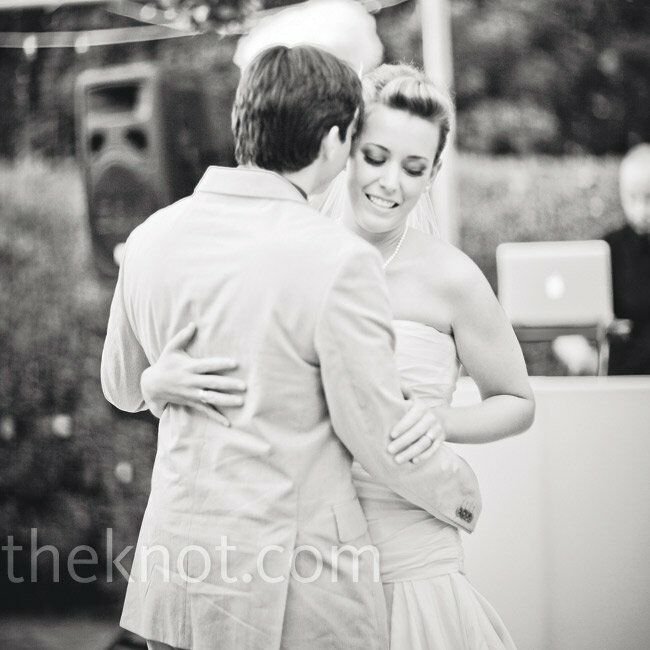 """Andrea and Jon took their first spin across the dance floor as the DJ played """"Showtime,"""" by Nelly Furtado."""