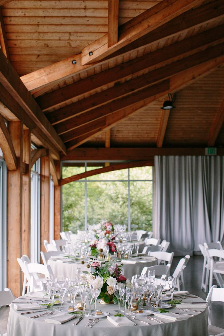 While Onteora's lodge read rustic, Julia and Lucas infused the cozy space with pale gray linens, gold accents and warm candlelight for a refined look. For a panache-packed twist, the couple wove pops of pink and lilac throughout and Viridescent Floral Design's lively arrangements delivered plenty of visual drama.
