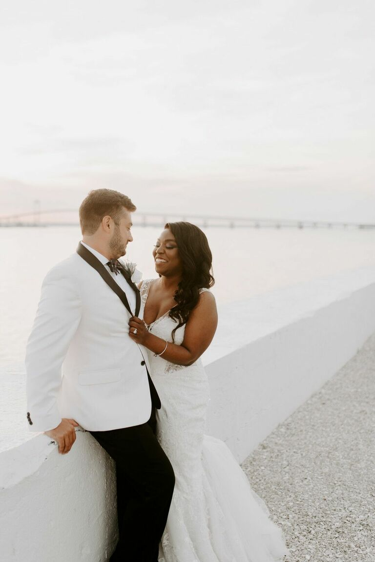 Waterfront portraits with bride and groom in white attire