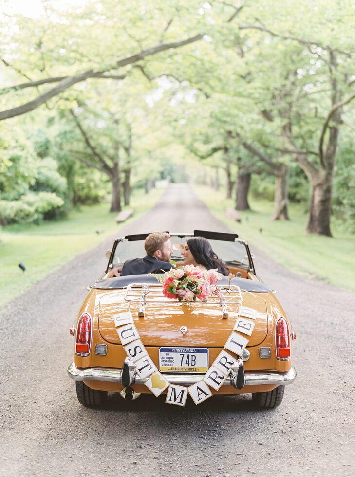 Couple Shares Kiss in Orange Getaway Car