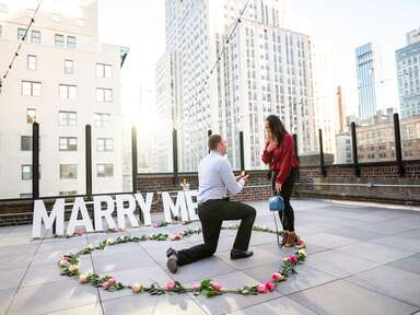 Marriage proposal on rooftop