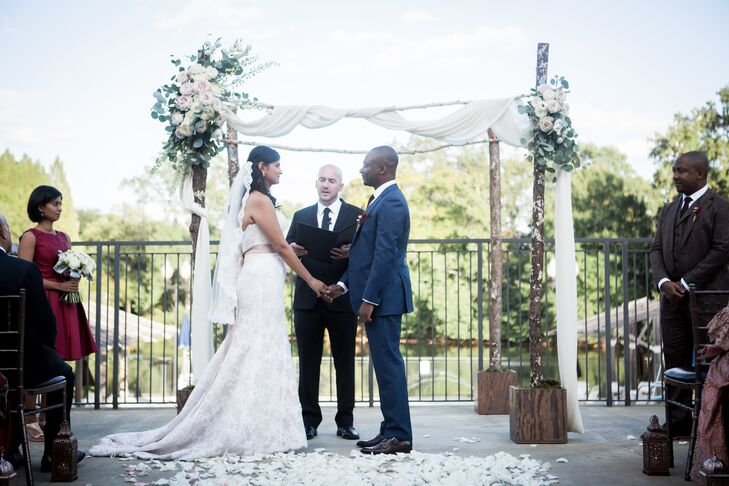 """After looking at a few venues in and around Atlanta, the Greystone at Piedmont Park fit  our vision perfectly,"" Aparna says. She and Kelechi exchanged vows in the garden before the indoor reception."