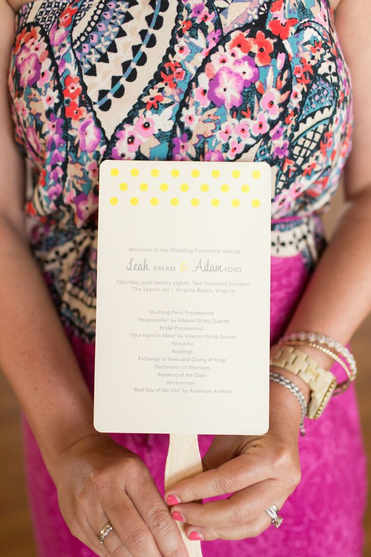 Programs at the ceremony doubled as fans. They featured a decorative yellow print border.