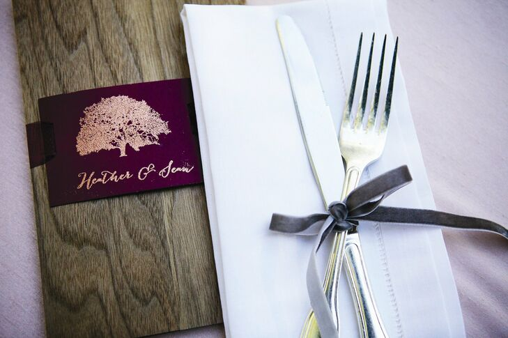The couple made a custom stamp and embossed the Southern oak tree design on their menu cards and other stationery.