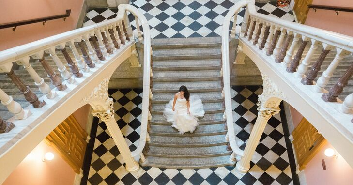 """""""The grand, black-tie ceremony took place in the rotunda. We chose to have the ceremony and reception at the same venue to help make the day seamless, but also for the breathtaking scenery inside this historic building,"""" Rachel says."""
