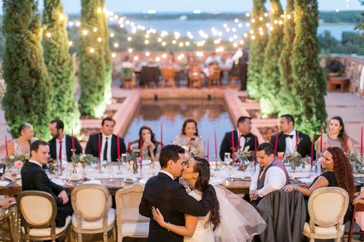 Michelle and Michael's Bella Collina Reception Kiss