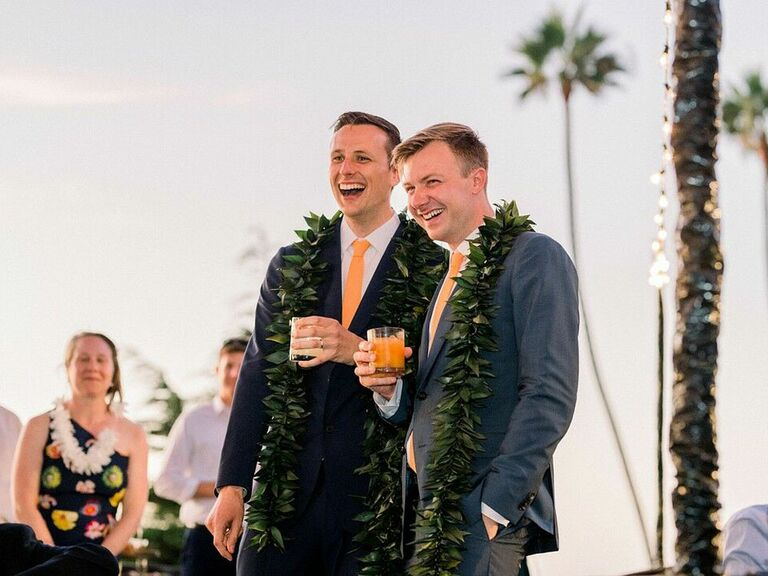 Grooms making welcome toast at wedding reception
