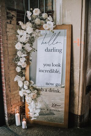 Formal Mirror Sign with White Flower Arrangement