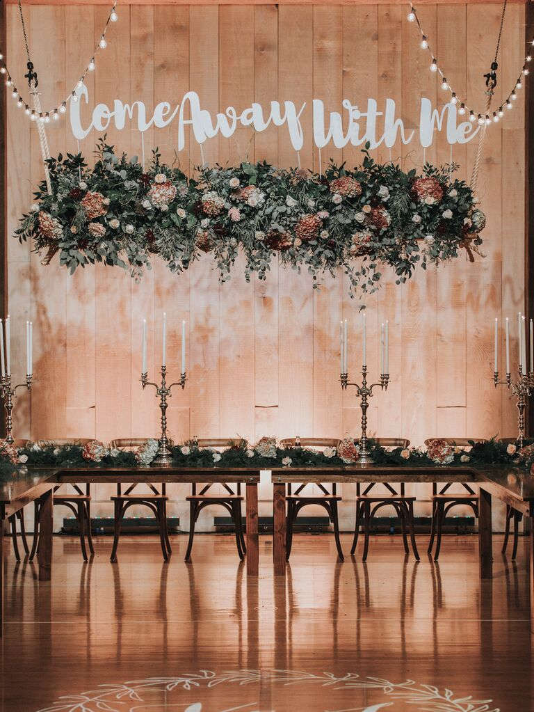Rustic wedding idea with hanging flowers