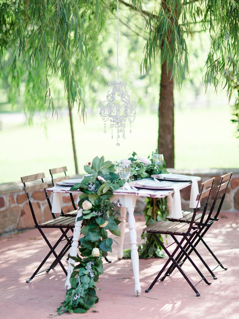 A Natural, Pastel Table Setting Accented With Greenery