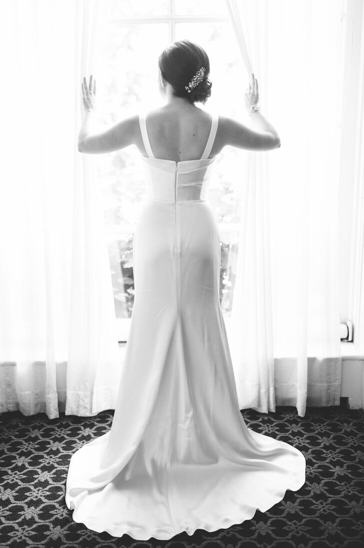 "Allison wore the Suzanne Neville ""Spellbound"" wedding dress. She bought the pretty, form-fitting gown from Wedding Atelier in New York City. She styled her hair in a low chignon and wore an embellished hair accessory for some sparkle."