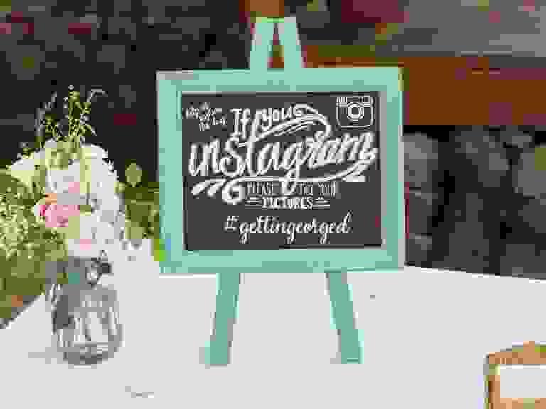 Chalkboard sign for Instagram wedding hashtag