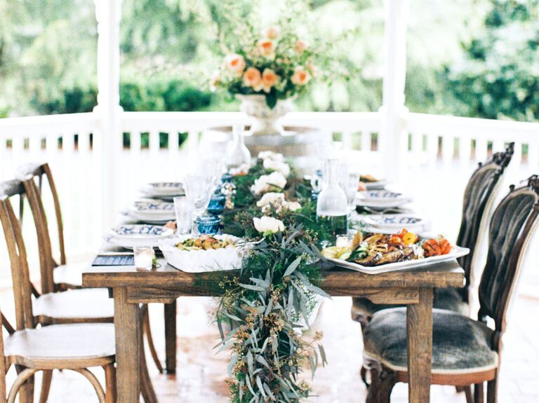 Outdoor rehearsal dinner in gazebo with garland table decor