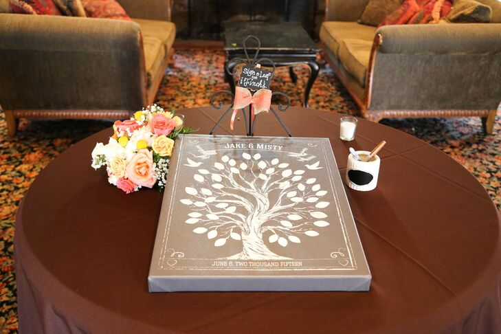 Instead of a traditional guest book, Misty and Jake had a brown-painted canvas with a tree design that guests signed.