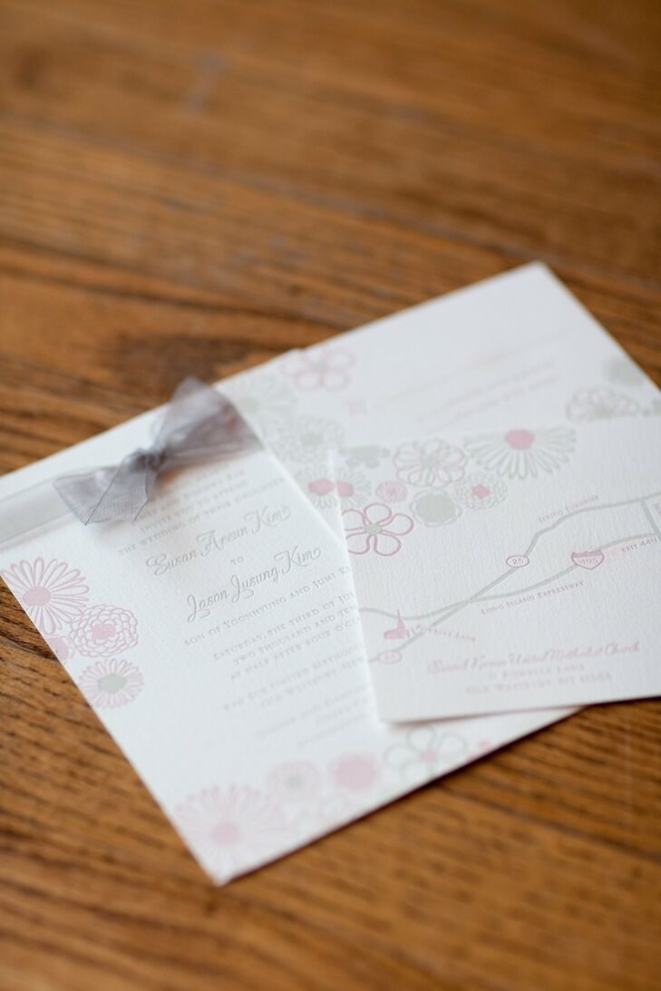 Susan and Jason's letterpress invitations were decorated with pastel flowers, soft green script and pale purple organdy ribbon.