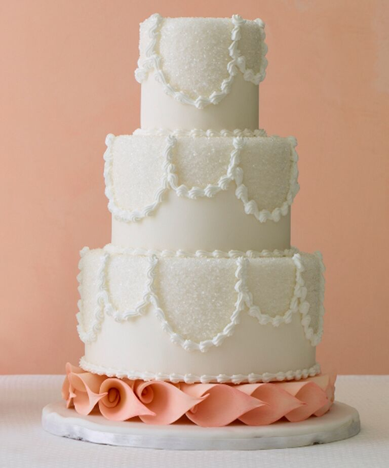White wedding cake with sugar crystal accents and calla lily base