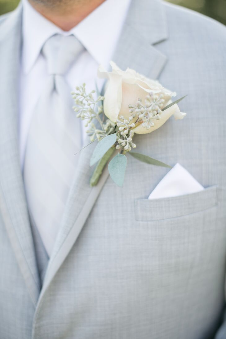 Andy accessorized his light gray suit with a single ivory rose boutonniere with a touch of seeded eucalyptus.