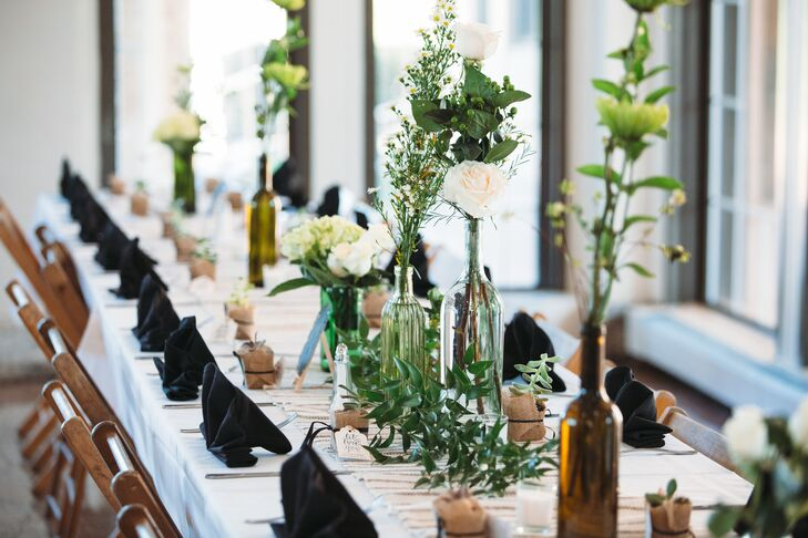 Minimalist Wine Bottle Centerpieces with Greenery, Baby's Breath and White Roses