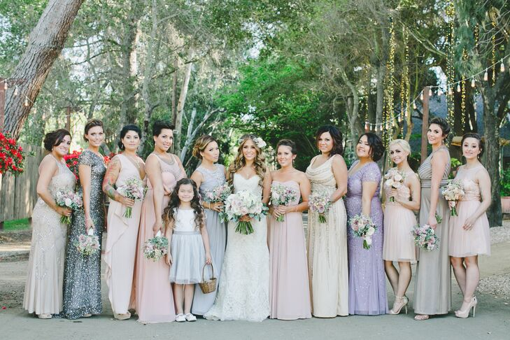 The young flower girl dressed in a white knee-length dress and a silver belt stood with Marisa and the rest of the bridesmaids. The ladies wore dresses in different styles, lengths and hues, creating a collection of pastels that matched the day's romantic vibe.