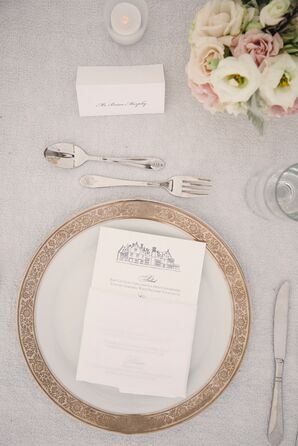 Place Setting with Gold-Rimmed Chargers and Custom Menus