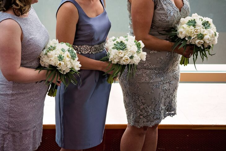 The bridesmaids carried white tulip and hydrangea bouquets, offset by green succulents designed by Laurel's On Whyte.