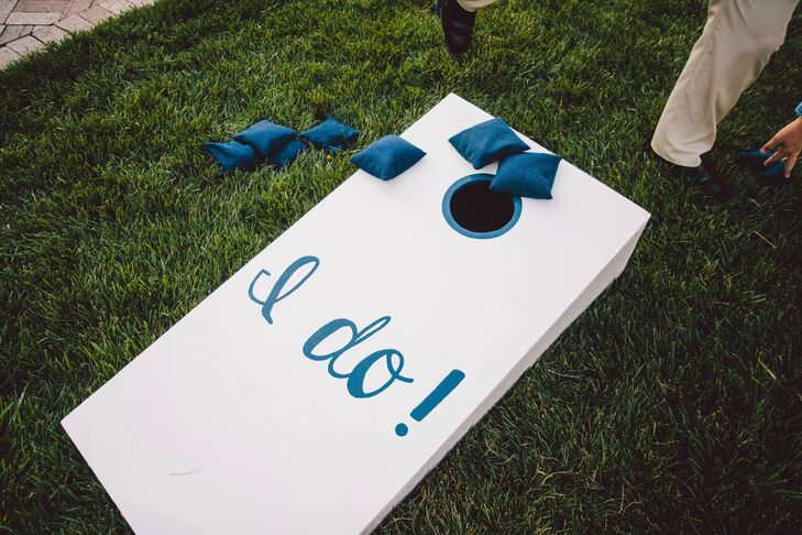 Guests played lawn games like cornhole during the cocktail hour.